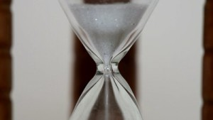 stock-footage-time-is-running-out-in-a-dusty-old-hourglass