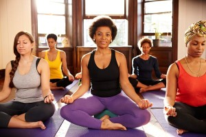 Women meditating in yoga class