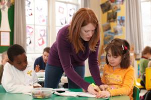 Teacher students helping teaching classroom