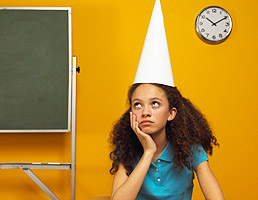 Girl with dunce cap in trouble school black discipline racism inequality
